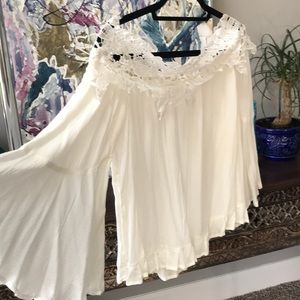 White, lace collared off-shoulder top.